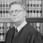 Illinois Circuit Court Judge Charles G. Reynard (www.McLeanCountyIl.gov, April 2012)
