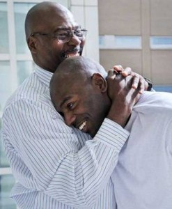 Robert Wilcoxson hugged by his father Robert Wilcoxson-Bey after his conviction was overturned on September 22, 2011. (CatholicLane.com)