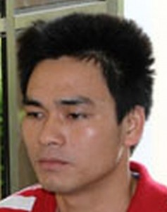 Ly Nguyen Chung in detention after his arrest on October 25, 2013.