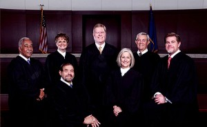 Nev. Supreme Court Justices (Dec. 2014) (supreme.nvcourts.gov) Seated: Justice Michael A. Cherry, Justice Kristina Pickering. Standing: Justice Michael L. Douglas, Justice Nancy M. Saitta, Chief Justice Mark Gibbons, Justice James W. Hardesty, Justice Ron D. Parraguirre.