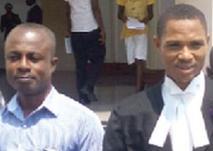 Eric Asante (in blue) with his lawyer, Francis Xavier Sosu outside the Supreme Court building in Accra after his acquittal on January 26, 2017. (Emmanuel Ebo Hawkson)