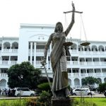 Statute of a blindfolded lady holding the scales of justice in front of Bangladesh Supreme Court annex building where it was installed on May 28, 2017 (Abir Abdullah/European Pressphoto Agency)