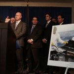 "Manhattan DA Cyrus Vance announcing indictment of 106 people for SSDI fraud on January 7, 2014, with photo displayed of an indicted ""disabled"" man who was sport fishing on a boat. (Michael Appleton - NY Times)"