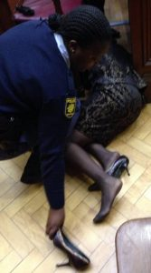 Thandi Maqubela lying on the courtroom floor after fainting during the reading of her verdict on Nov 6, 2013 (enca.com)